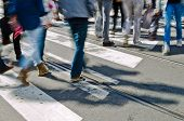 stock photo of intersection  - People walking on a crossing on a busy workday - JPG