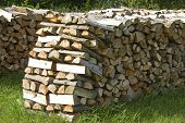 image of cleaving  - Stack with fire logs of broad - JPG