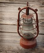 Retro Kerosene  Lamp On A Wooden Table