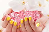 stock photo of nail paint  - Woman in nail salon receiving manicure by beautician