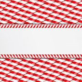 foto of candy cane border  - Background made of candy canes with place for your text - JPG