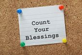 foto of blessing  - The phrase Count Your Blessings typed on a piece of lined paper and pinned to a cork notice board - JPG
