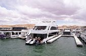 stock photo of houseboats  - Pier for houseboats amd boats in Lake Powell USA - JPG