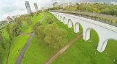 stock photo of aqueduct  - Green park with aqueduct in city - JPG