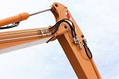 picture of bulldozers  - Detail of hydraulic bulldozer excavator arm construction machinery sky background - JPG