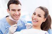 stock photo of medical examination  - Male dentist and woman in dentist - JPG