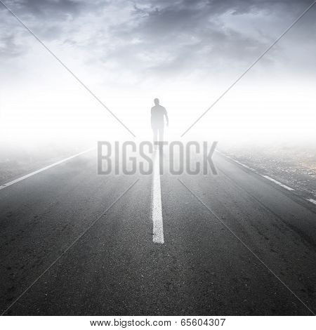 Asphalt Highway Perspective With Walking Man In The Fog