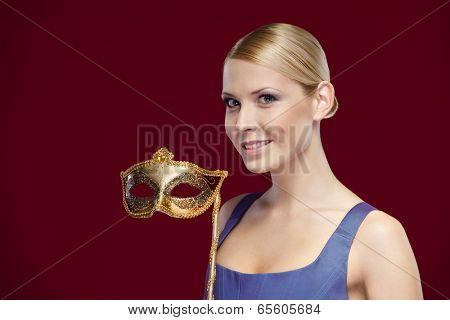 Beautiful woman with masquerade masque, isolated on purple