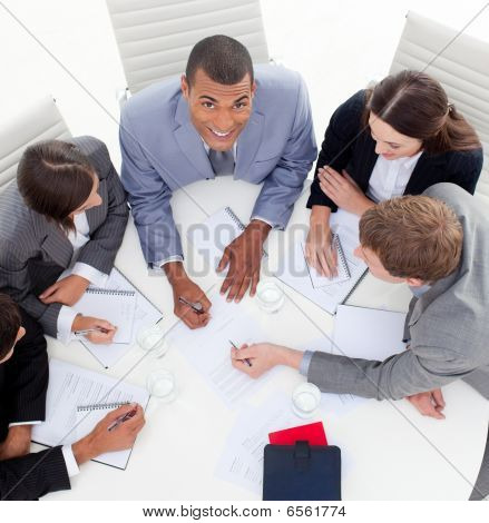 High Angle Of Business People Studying A New Budget Plan