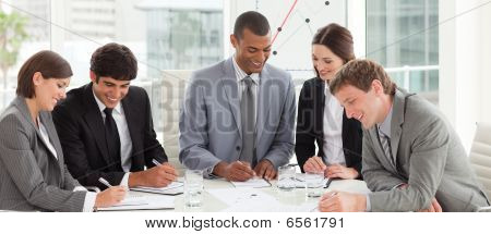 A Diverse Business Group Studying A Budget Plan