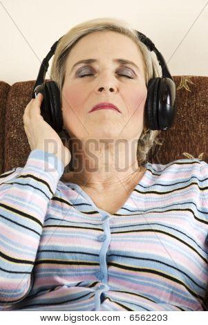 Mature Woman Listeni Music In Headphones