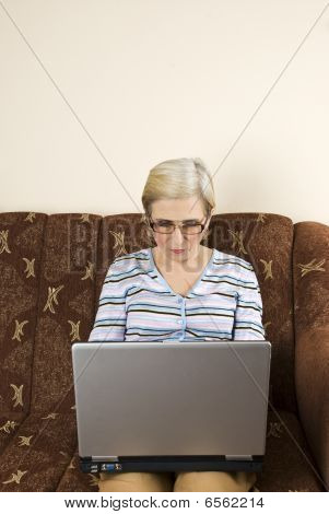 Senior Woman Work On Laptop