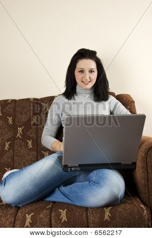 Girl Using Laptop  In Her Couch