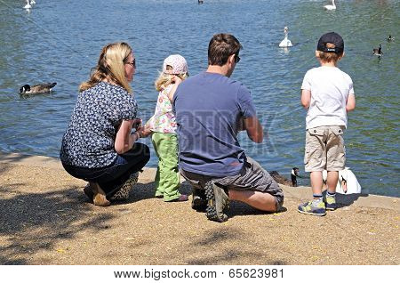 Family feeding ducks, Stratford-upon-Avon, UK.