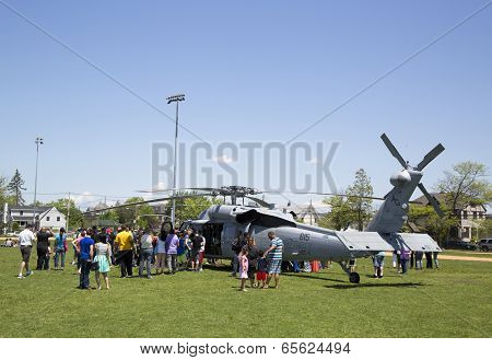 Numerous spectators around MH-60S helicopter from Helicopter Sea Combat Squadron Five
