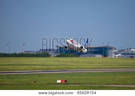 BUDAPEST, HUNGARY - MAY 02: Boeing 737 airliner taking off at Budapest Airport (LHBP), May 2 2014. The new terminal building called Skycourt was completed in 2012.