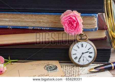 antique clock with  old  books and letters background