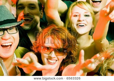 Cheering crowd in disco club