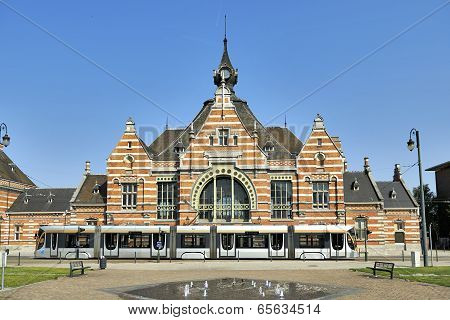 Brussels, Belgium - July 07, 2013: A Tram Passing In Front Of The Entrance Of The Schaerbeek Train S