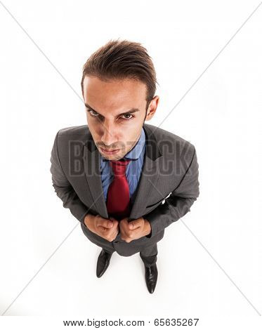 Suspicious businessman portrait. Isolated against white background. Wide lens used