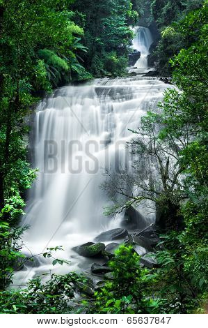 Tropical Rain Forest Landscape With Jungle Plants And Flowing Water Of Sirithan Waterfall. Mae Klang