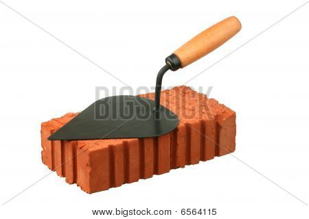 Building trowel and red brick
