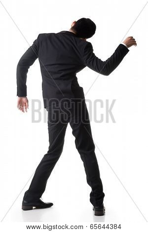 Marionette pose, asian business man isolated on white.