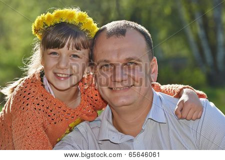 Smiling father man with daughter outdoors