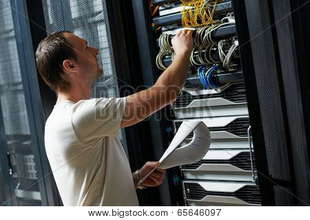 network engineer working in server room