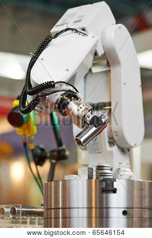 Robotics. Mechanical precision arm of robot manipulator with detail during positioning at facory