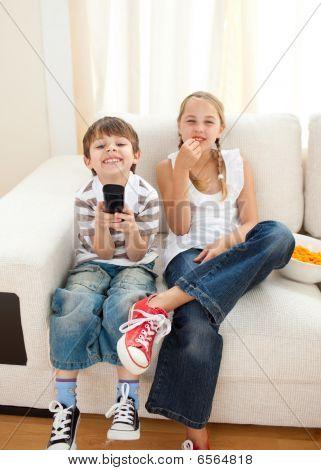 Happy Siblings Watching Tv