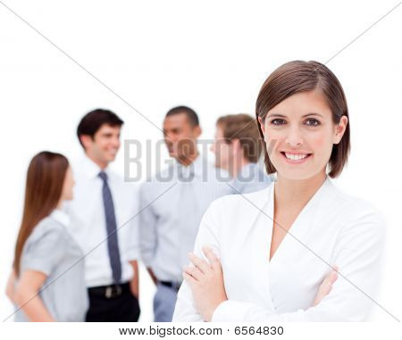 Confident Manager In Front Of Her Team With Folded Arms