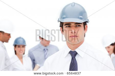 Serious Male Architect In Front Of His Team
