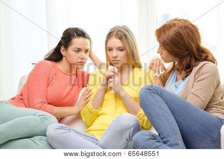 friendship and people concept - two teenage girls comforting another after break up