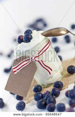 Jar Of Clotted Cream Or Yogurt With Blueberries