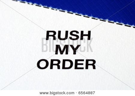 """Rush My Order"" from a business reply postcard isolated on blue"