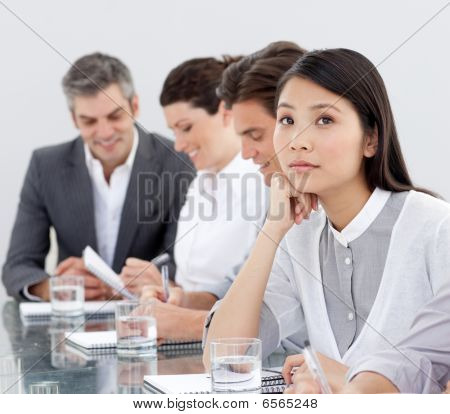 Young Businesswoman Bored At A Presentation