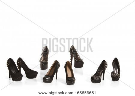 Collection of black high heel shoes on white background