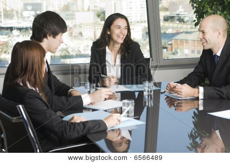 Business training where group of persons is sitting at a table