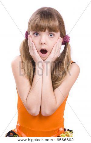 Little Girl In Orange Dress Looking Surprised
