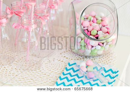 Candy jar on a dessert table at party or wedding celebration