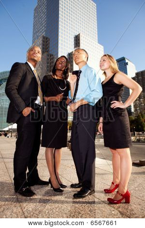 Four Business People Looking Upwards