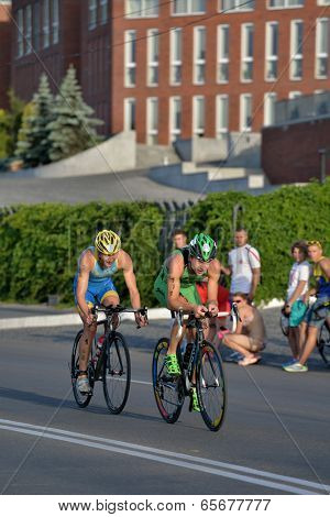 DNEPROPETROVSK, UKRAINE - MAY 24, 2014: Yegor Martynenko and Sergiy Kokhan leading in the 2 stage of ETU Sprint Triathlon European cup. It's the first time Triathlon European Cup take place in Ukraine