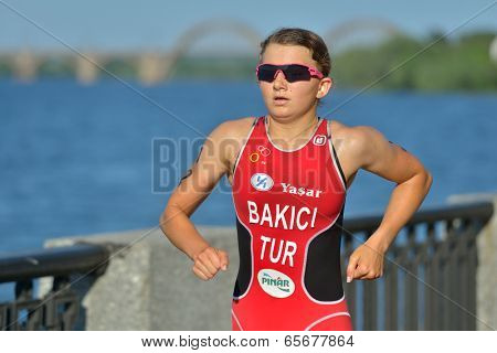 DNEPROPETROVSK, UKRAINE - MAY 24, 2014: Ece Bakici of Turkey runs on the third stage of ETU Sprint Triathlon European cup. It's the first time Triathlon European Cup take place in Ukraine