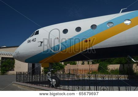 KIEV, UKRAINE - MAY 26, 2014: The monument of airplane Yak-40 (Codling) near technical laboratories of National Polytechnic University on May 26, 2014 in Kiev, Ukraine