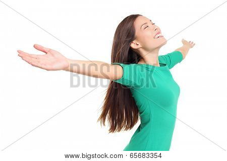 Happy worshipping praising joyful elated woman with arms raised outstretched smiling joyful and ecstatic full of happiness with eyes closed isolated on white background in studio. Mixed race female.