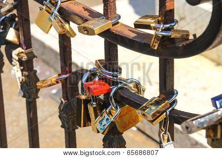 Padlocks On The Fence Of Bridge In Florence, Symbolizing Eternal Love