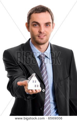 Man With Toy House