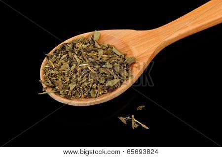 Herbes De Provence (mixture Of Dried Herbs) In Wooden Spoon On Black Background