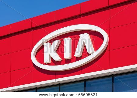Samara, Russia - May 24, 2014: The Emblem Kia Motors On The Office Of Official Dealer. Kia Motors Is